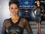 Stunning: Halle Berry wore an eye-catching black leather and semi-sheer dress at the Moscow premiere of her new movie Cloud Atlas
