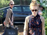 No wonder she wants to show it off! January Jones reveals her trim tummy (and underwear) in sheer top for lunch outing
