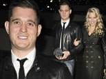 That's how to do couple chic! Michael Bublé and wife Luisana make a stylish exit in matching leather coats