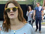 Domestic bliss: Drew Barrymore out furniture shopping and back to basics with husband after recent first red carpet appearance since birth of baby Olive