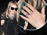 Halloween is over Fergie! Singer keeps scary theme going with her goblin-green pointy manicure