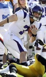 Northwestern backup quarterback Dan Persa helped the Wildcats win at Iowa to become bowl-eligible.