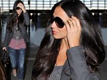 Low key glamour: Relaxed Demi Moore works the casual style in simple jeans and blazer as she jets out of LAX