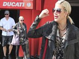 Now that's a biker chick! Tori Spelling sports a battered leather jacket and boots as she heads to motorcycle repair shop with husband Dean