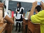 Fancy that: A young Chinese teacher wears a sexy maid's outfit, complete with a cute pair of cat ears, after promising to do so if her pupils got good marks in their test