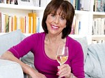 Wine o'clock: Liz Hodgkinson is pictured enjoying a glass of wine at home. She says that it¿s almost impossible to wait until six in the evening to have her first glass of wine