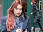 What storm? Life goes on as normal for Lindsay Lohan as she enjoys posh New York lunch