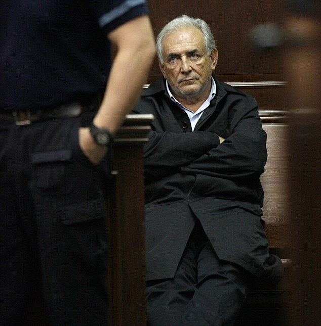Disheveled: Dominique Strauss-Kahn is pictured appearing for an arraignment in a federal court in New York last year