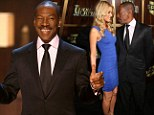 No wonder he's smiling! Eddie Murphy shows off latest squeeze Paige Butcher at TV tribute evening