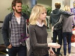 Date night: Emma Stone cuts an adorning figure as she spends the evening with beau Andrew Garfield