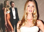 Launch: Rosie Huntington-Whitely and fashion designer Christopher Bailey pose during the opening ceremony of the new Burberry flagship store in Hong Kong.