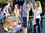 Happiest place on Earth: Bella Thorne shares ice-cream...and smooches with boyfriend Tristan Klier at Disneyland