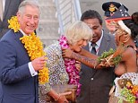 Prince Charles and Camilla, Duchess of Cornwall, presented with garlands