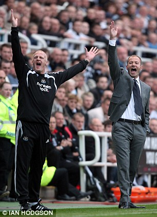 Hands up: Newcastle boss Alan Shearer and assistant Iain Dowie appeal in unison to the referee