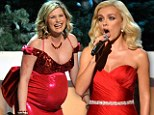 Opera star Katherine Jenkins sings at country Christmas show in red gown... as host displays baby bump in matching dress