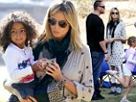 Spots and stripes: Heidi Klum pulls off mismatched prints as she enjoys son Henry's football game with her boyfriend and daughters