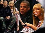 Date night: Beyonce and Jay-Z enjoyed time out from stormy weather at a basketball game on Saturday night