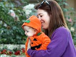 Pumpkin patch: Alyson Hannigan carried six-month-old Keeva who was dressed in a cute baby Halloween outfit on Sunday