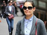 Katie Holmes looks fed up in another grey cardigan...still 'homeless' and living in a hotel after Superstorm Sandy left her luxury apartment with no power