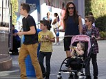 No wonder she loves heels! Victoria Beckham tries out flat shoes... and finds herself looking up at son Brooklyn, 13