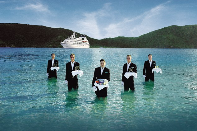 Seabourn's waiters are pictured serving caviar in the sea