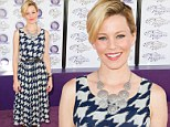 The Hunger Games star Elizabeth Banks makes a fashion fail in loud dress at the Breeders' Cup World Championships in California on Saturday
