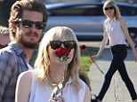 Everything's coming up roses: Emma Stone and Andrew Garfield took a Cemetery of the Stars Tour at the Hollywood Forever Cemetery in Los Angeles on Saturday