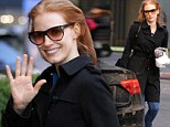 Actress Jessica Chastain waves and signs an autograph as she arrives at Walter Kerr Theatre for her matinee performance of The Heiress in New York City on Sunday