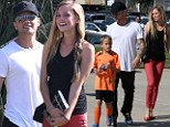 They're a match: Ryan Phillippe took over father duties at his son Deacon's soccer match on Saturday, and his girlfriend Paulina Slagter came along
