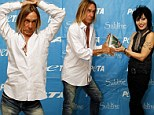 Strike a pose: Iggy Pop cast his eyes down at the cameras as he posed on the red carpet at a PETA event honouring Joan Jett in Fort Lauderdale, Florida on Sunday