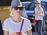 Keeping it under her hat: Elizabeth Banks is low key in tweed trilby, T-shirt and jeans for a leisurely day out at the Farmer's Market