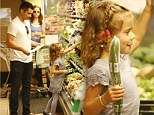 Just the two of us! Cash Warren and daughter Honor pick out produce at a grocery store in Beverly Hills, California on Sunday