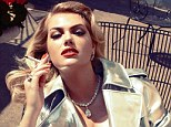 Smoking! Kate Upton looks out of this world in a silver trench coat in the Italian edition of Vogue but indulges in a very bad habit