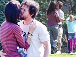 Make-out session: Mark Wahlberg and his wife, Rhea Durham, got in plenty of PDA during their son's soccer game on Saturday