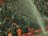 Water torture: Fans are soaked by a broken sprinkler
