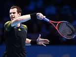 Take that: Andy Murray fires a return back at Tomas Berdych in their opening clash at the ATP Tour Finals