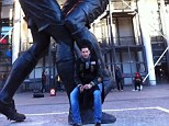 You Twit: Former Italy defender Marco Materazzi poses by the statue of his infamous World Cup final clash with French legend Zinedine Zidane in 2006