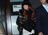 Front seat driver! Lindsay Lohan tries her hand at being a passenger... as she steps out in a mismatched outfit for night out