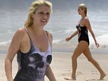 By the power of grayskull... Ke$ha's beach look is saved by quirky one-piece