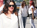 Drew Barrymore was given some help with her heavy shopping bags during a trip to the store on Sunday.