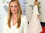 Still in white: Newlywed Cat Deeley steps out at fashion awards show wearing a fluffy tiered dress