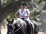 Heading for the sunset: Jillian Michaels and her partner Heidi Rhoades go on a romantic date horseback riding