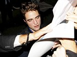 Fan frenzy: R-Patz looks drained as he is mobbed outside Jimmy Kimmel studios on Monday evening