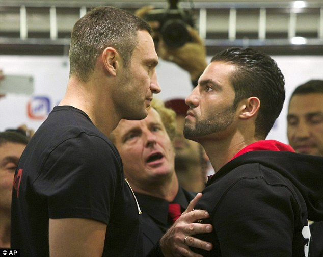 Head to head: Vitali Klitschko (left) defends his heavyweight world title against Manuel Charr in Russia