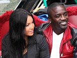 Happy couple: Akon sports a huge grin as he enjoys a gondola ride with a mystery brunette in Venice on Saturday