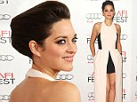 Tres chic! French actress Marion Cotillard is divine in Dior as she displays her slender figure in edgy black and cream gown