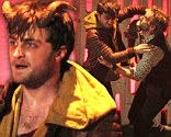 Locking horns! Snarling Daniel Radcliffe grapples with co-stars in violent fight scene for new horror film