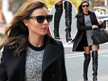 Ready for the runway! Miranda Kerr shows off her long legs in thigh high leather boots as she prepares for Victoria's Secret show
