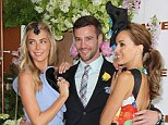 Ladies' man: Dannii Minogue's former fiance Kris Smith cosies up to a bevy of beauties at the Melbourne Cup Carnival on Tuesday