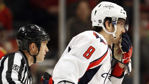 Washington Capitals' Alex Ovechkin, right, leaves the ice after his hit on Brian Campbell during the first period on Sunday.